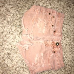 I am selling these burned rose colored shorts